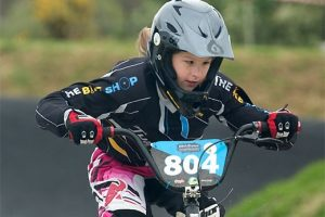 Chisnallwood Intermediate School's Lily Hovell negotiates the Tauranga BMX track during the 2016 NZCT AIMS Games. Photo: AIMS Games