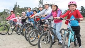 Riley Foote, left, Phebe Simpson-Allan, Esther Kerr, Elijah Kerr, Axell Simpson-Allan, Jacob Kerr, Tyson Foote, Dylen Foote and Sadee Simpson-Allan are excited plans are moving forward to build a BMX track in Blenheim. Photo: SVEN HERSELMAN/FAIRFAX NZ